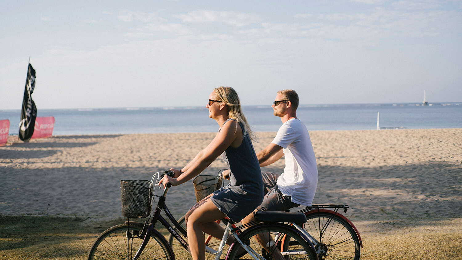 A couple enjoying a bicycle ride in Bali